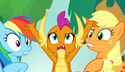 Smolder (centre) raises arms in frustration at a startled Rainbow (left) and Applejack (right)
