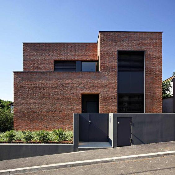 Dise os de casas modernas en ladrillo licencias de for Modern mud house architecture