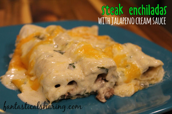 Steak Enchiladas with Jalapeno Cream Sauce // These beef enchiladas are smothered in a homemade jalapeno cream sauce and it is divine! #recipe #maindish #enchiladas #steak #beef