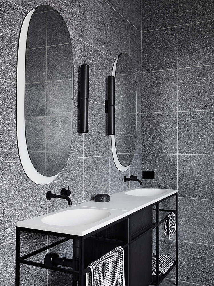 Contemporary bathroom with gray tiles designed by Studio Griffiths, styling by Studio Moore and photo by Sharyn Cairns