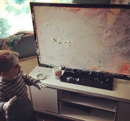 little boy painting television