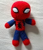 http://www.ravelry.com/patterns/library/spiderman---mini-doll-crochet-pattern