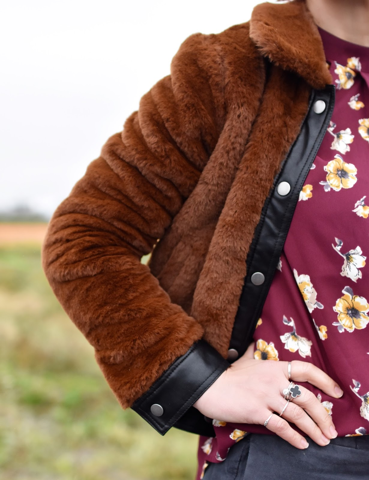 Outfit inspiration c/o Monika Faulkner - styling a Forever 21 faux-fur bomber jacket over a floral blouse