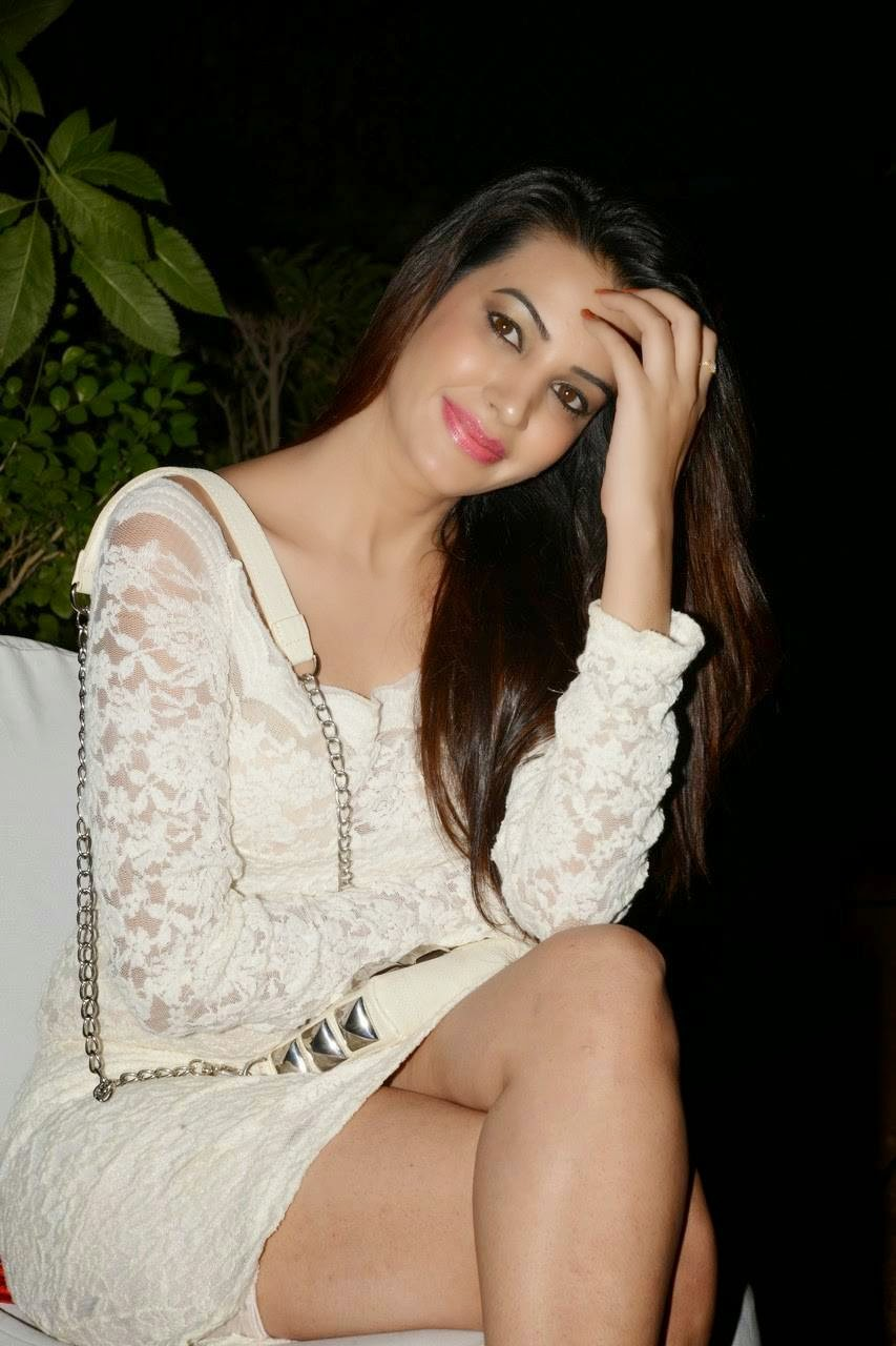 Actress Diksha Panth Pictures, Actress Diksha Panth Crossleg Sitting Pics in White Dress from Event