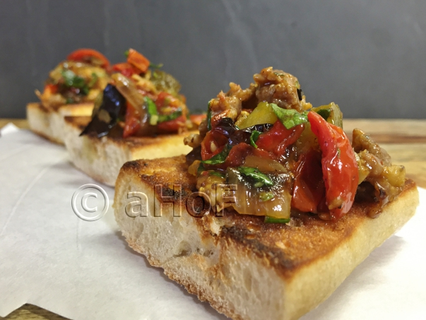Caponata with Italian Sausage atop Toasted Ciabatta
