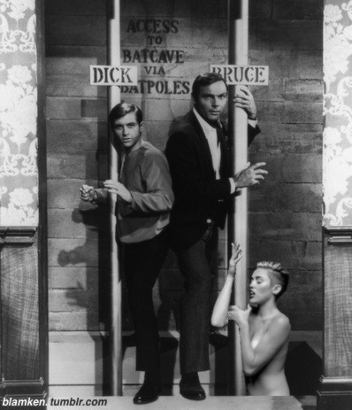 Burt Ward and Adam West posing as Dick Grayson and Bruce Wayne on their Batpoles in Wayne Manor's library with Miley Cyrus from 'Wrecking Ball' video pasted in on pole below them