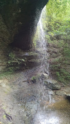 Underneath the waterfall at Fall Hollow
