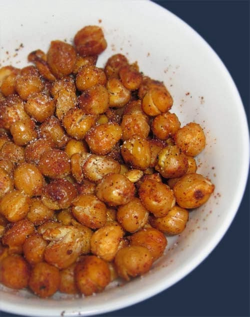 Roasted chickpeas are healthy snacks easily made at home. All you'll need is a can of chickpeas (a.k.a. garbanzo beans), some olive oil and seasoning and you're good to go (or no seasoning for plain serving). Great source of fiber and protein. Completely vegan.