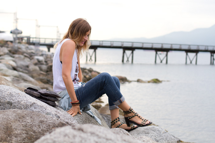 Vancouver Fashion Blogger, Alison Hutchinson, wearing a sleevess white choices LOVE top with the WWF panda, Urban Outfitters Chambray top tied around the waist, Zara boyfriend jeans, H&M gladiator black sandals, and a Botkier silver Vakentina Bag