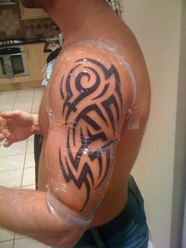 Awesome Tribal Chest And Sleeve Tattoo | Fresh Tattoo Ideas