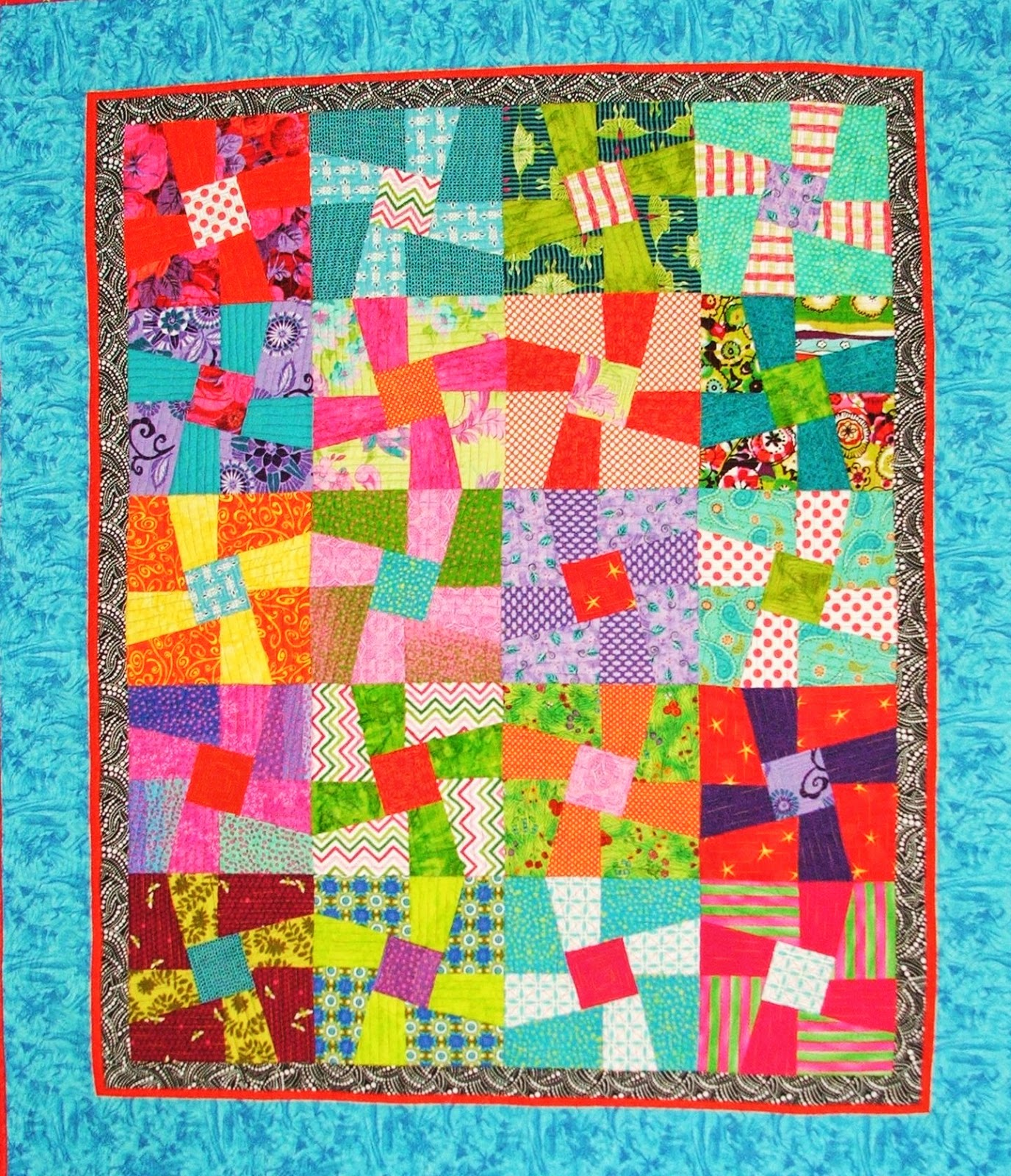 Helen Has Made Her Twisted Sister Quilt Varying The Direction Of Blocks And Using Brights