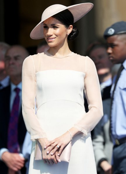 Meghan Markle wore Goat Fashion Flavia Dress, and Tamara Mellon 'Siren' blush nappa leather pumps, she carried Wilbur and Gussie bespoke silk clutch