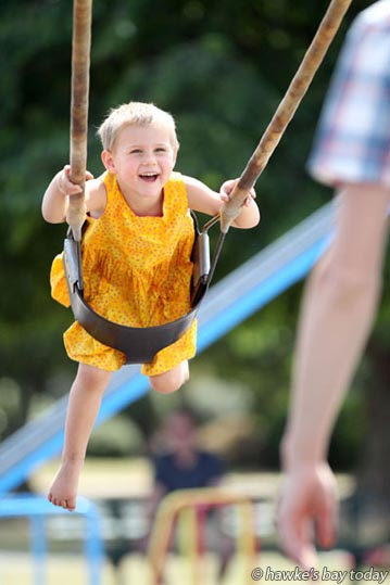 Jocelyn Kessels, 4, Napier, on a swing at Nelly Jull Park, Waipawa, in hot sunny summer weather. photograph