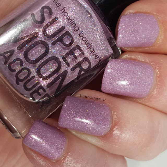 pale lilac nail polish with holographic flakes