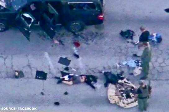 San Bernardino : One suspect was seen on television lying lifelessly next to a black SUV riddled with bullet holes.