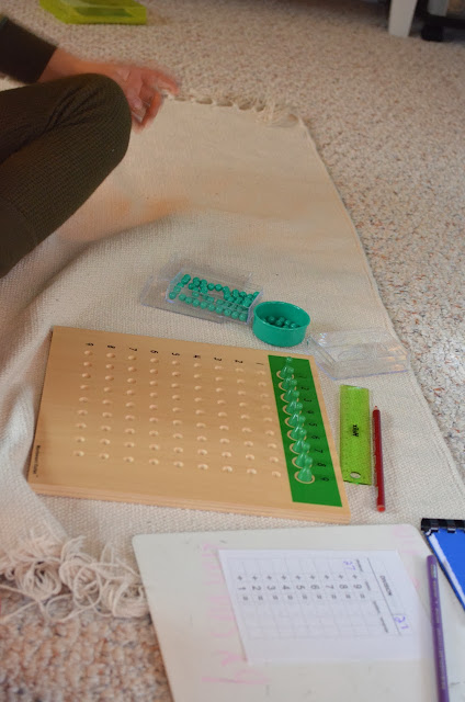 Montessori division bead board and tables paper