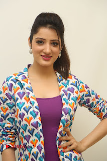 Actress Richa Panai Pictures in White Jeans at Eedu Gold Ehe Movie Interview  0005.JPG
