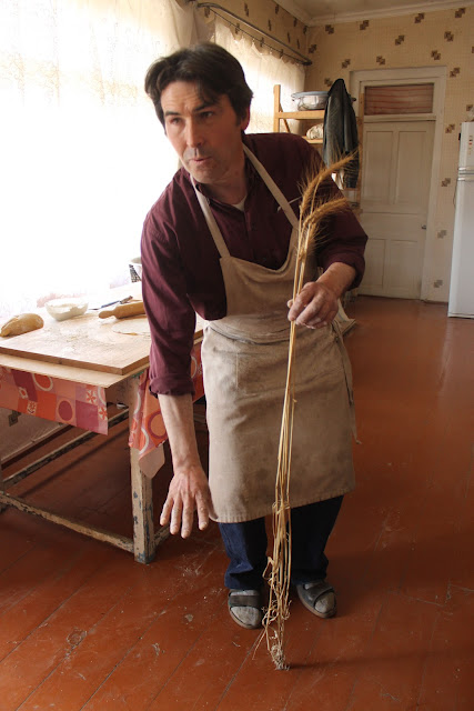 Jean Jacques showing the tall wheat Dolis Puri.