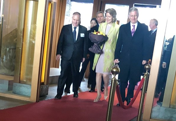 Queen Mathilde wore a green floral print coat by Emporio Armani, and Dries Van Noten grey satin floral coat, Armani bag and Armani pumps