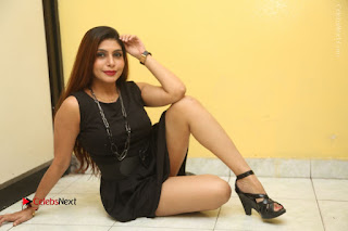 Tollywood Upcoming Actress Pooja Roshan Stills in Black Short Dress at Plus 1 Movie Trailer Launch  0382.JPG