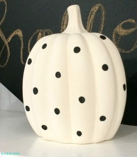 I used items from the dollar store to decorate ceramic pumpkins three different ways for Halloween.