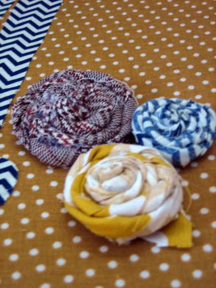 I used excess fabric to add embellishes like these fabric flowers