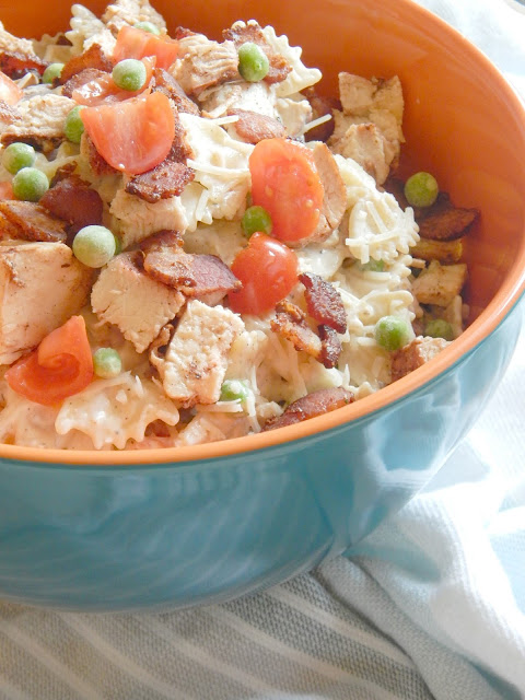 Chicken Bacon and Ranch Pasta Salad...a creamy, homemade dressing is tossed with grilled chicken, bacon, pasta, veggies and cheese!  Such a great salad for entertaining, grilling out, a fun side dish or even the main meal! (sweetandsavoryfood.com)