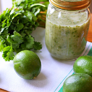 cilantro lime vinaigrette with limes and cilantro next to it