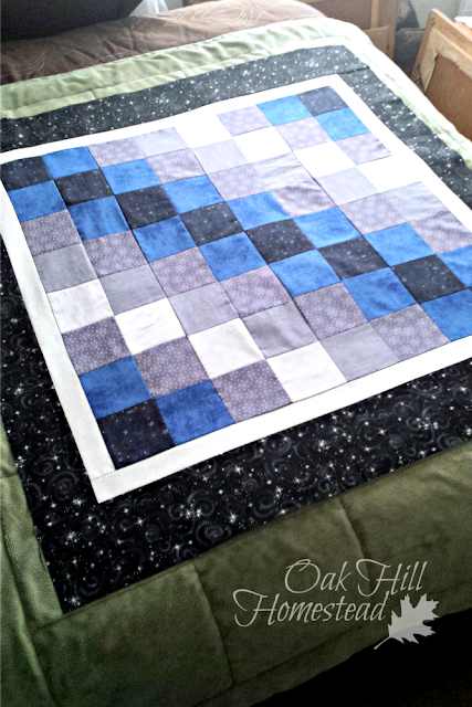 The patchwork top for the Starry Night crib quilt.