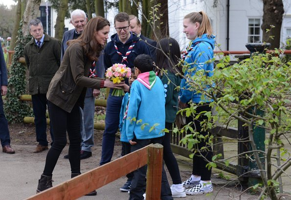 Kate Middleton is wearing her J Crew Mockneck sweater and Chloe boots