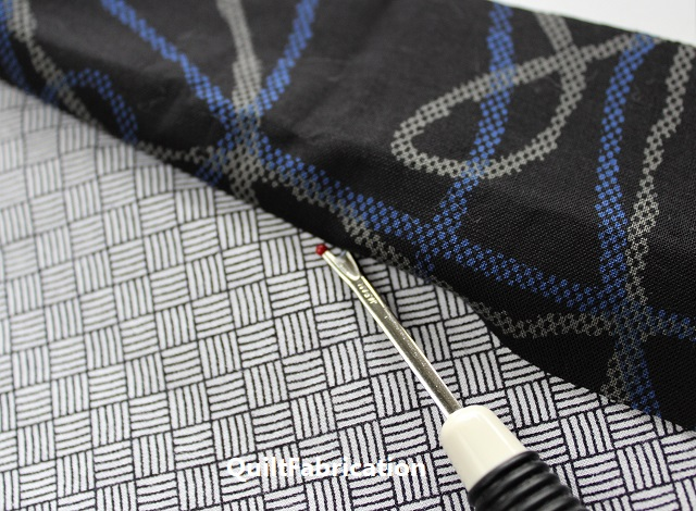 seam ripper blunting ball against keeper fabric