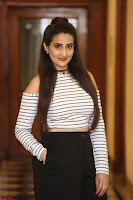 Manjusha in sleevelss crop top and black skirt at Darshakudu pre release ~  Exclusive Celebrities Galleries 114.JPG
