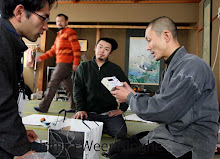 Japanese Buddhist monk sees the radiation level checking detector