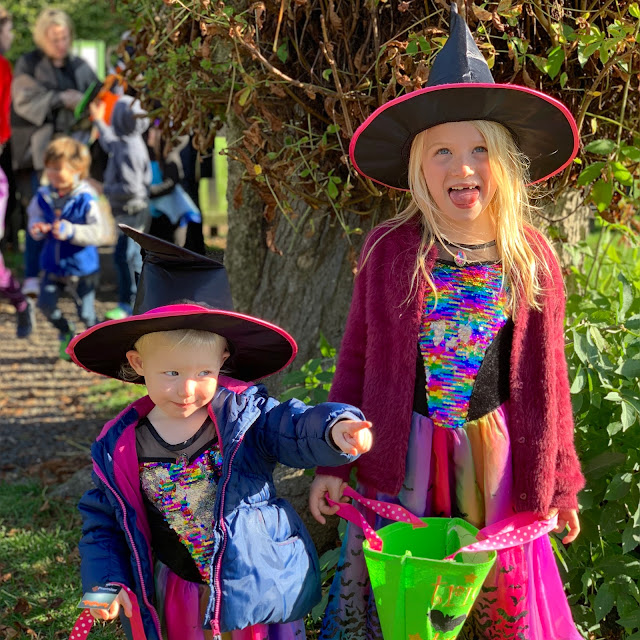 2 girls dressed in Tu Sainsburys witches dresses for Halloween at Audley End Railway