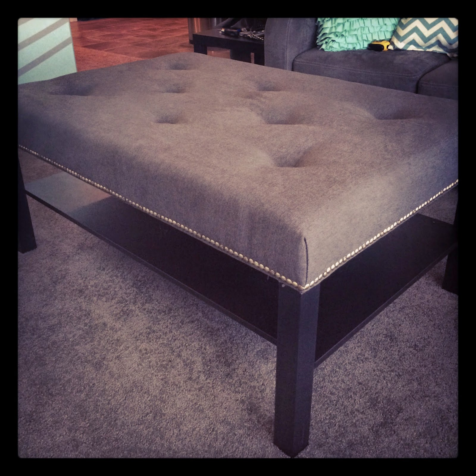 My beautiful new ottoman that I made with our old Lack coffee table, and  about $65 in supplies.
