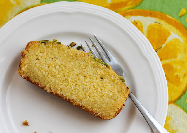 "Food Lust People Love: Kalo prama, καλό πράγμα in the original Greek, translates as ""good stuff."" I can assure you that this Cypriot semolina cake is indeed very good stuff! The batter is easy and a lemon syrup adds even more flavor and a delightful stickiness that makes it hard to stop with just one slice."