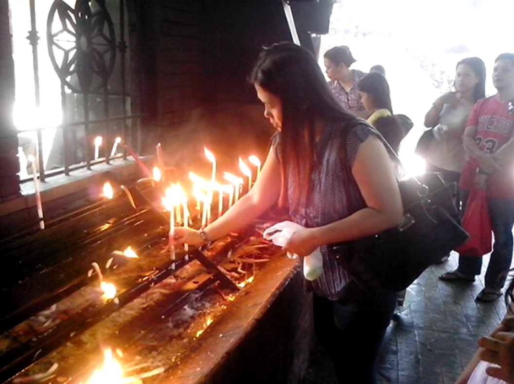 Our Lady of Manaoag Church -Light candles to remember your dearly departed.