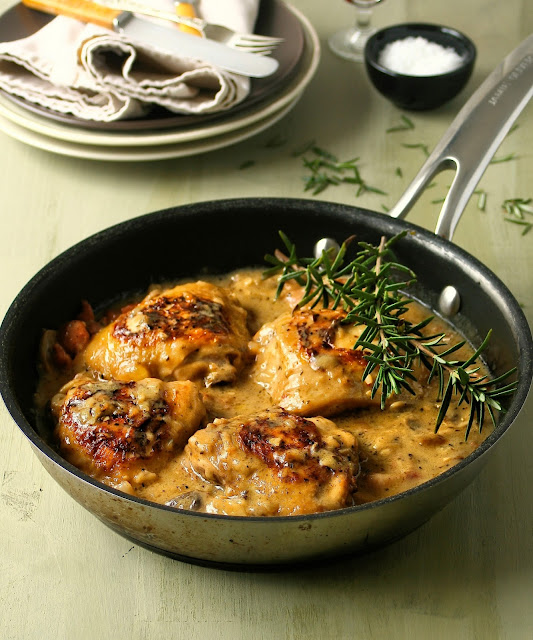 Chicken thighs in a creamy sauce with lemon and rosemary.