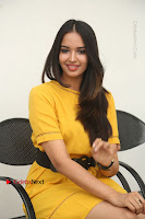 Actress Poojitha Stills in Yellow Short Dress at Darshakudu Movie Teaser Launch .COM 0283.JPG