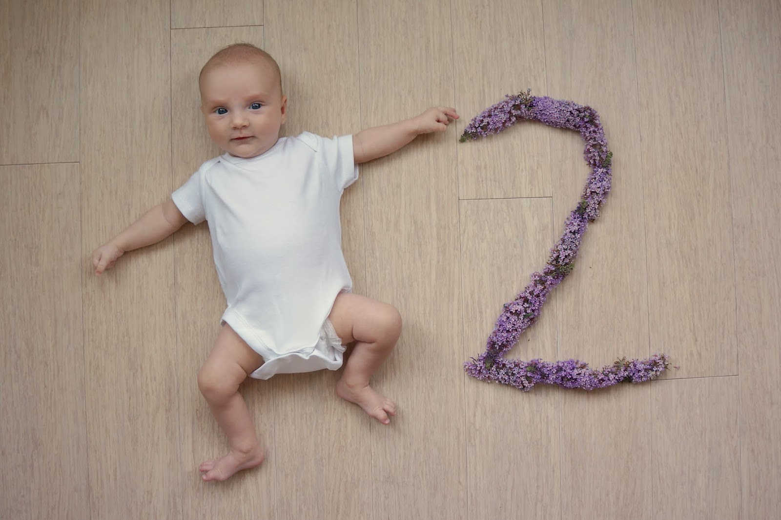 baby with flower number two