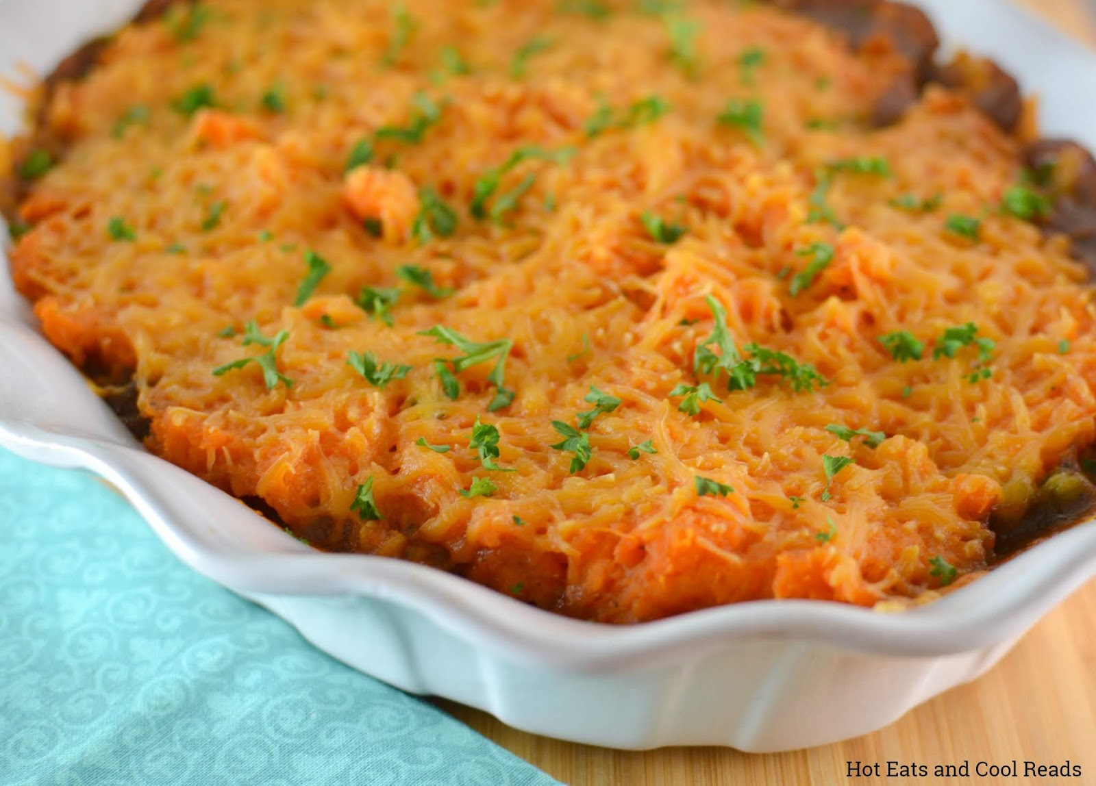 Sweet Potato Beefy Shepard's Pie Recipe from Hot Eats and Cool Reads! This comfort food casserole is perfect for dinner! Topped with delicious mashed sweet potatoes and packed with delicious ground beef and vegetables!
