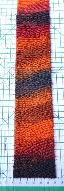 'Slip Slope' scarf in 'Vesuvius' colours on the blocking board.