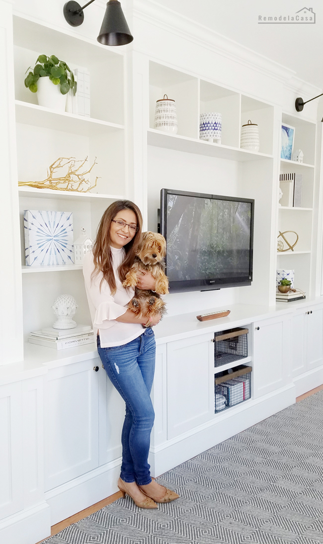 Cristina Garay and her pet Louie in front of her latest project.