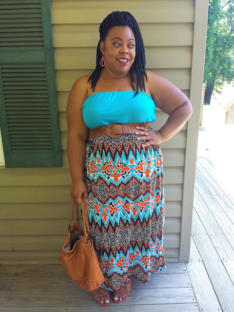 plus blogger in maxi, lace up wedges, and faux locs