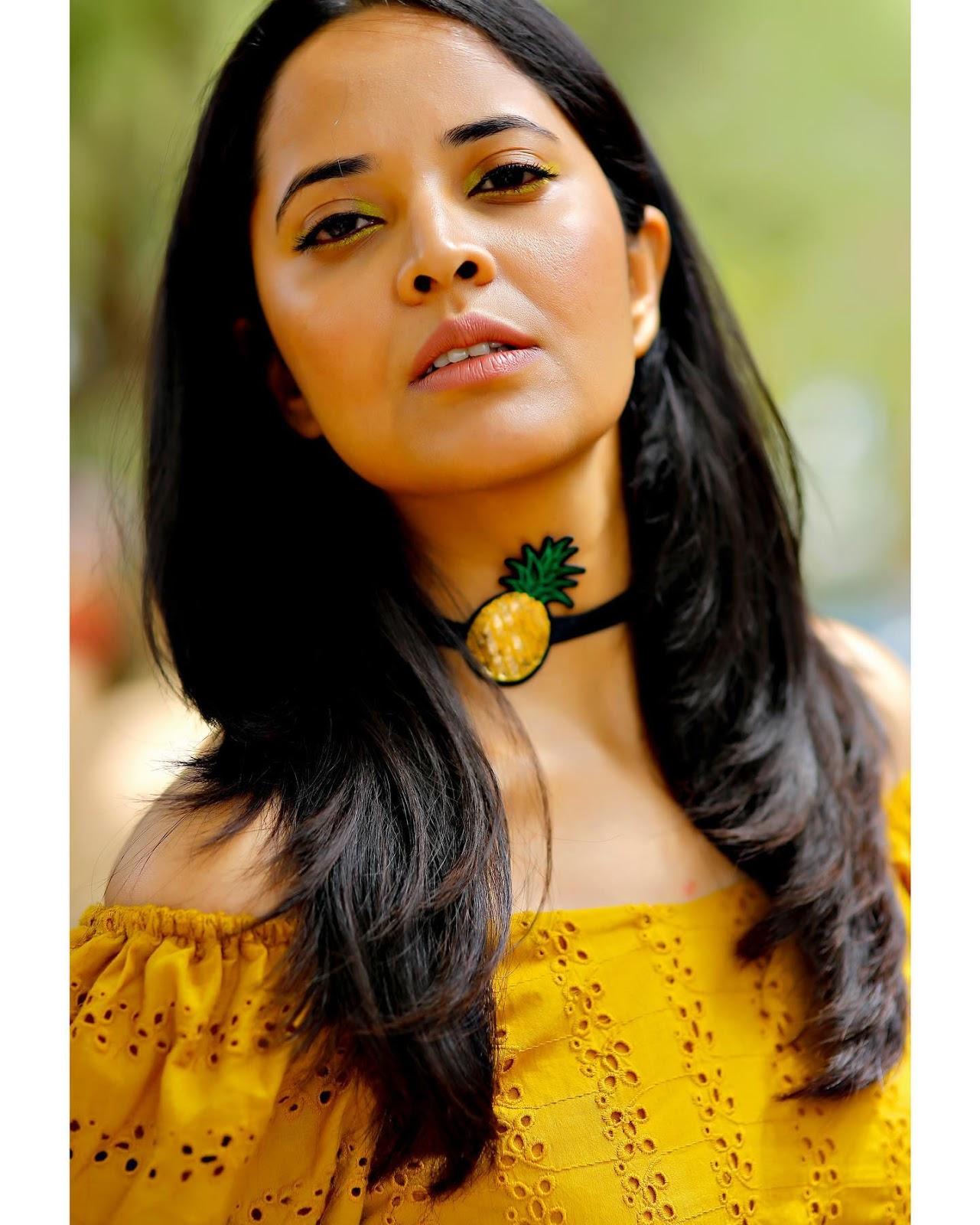 Indian TV Actress Anasuya Long Cross Legs In Yellow Skirt