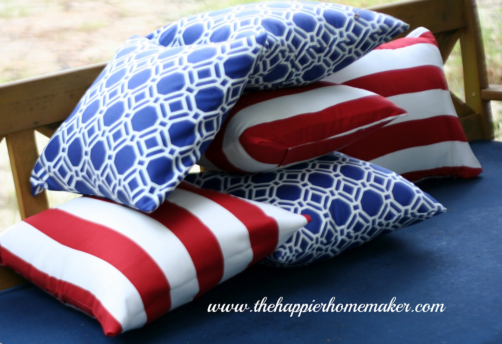 stqck of multiple patriotic red white and blue curtains on an outdoor patio chair