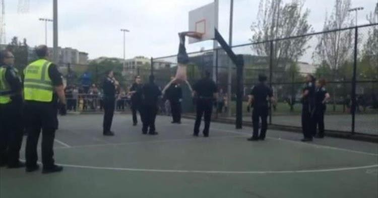 Cops playing basketball