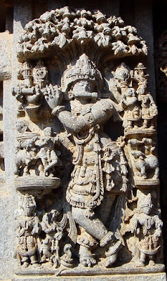 Krishna playing the flute beneath a tree, surrounded by gopis. Chennakeshava Temple, Somnathpur.