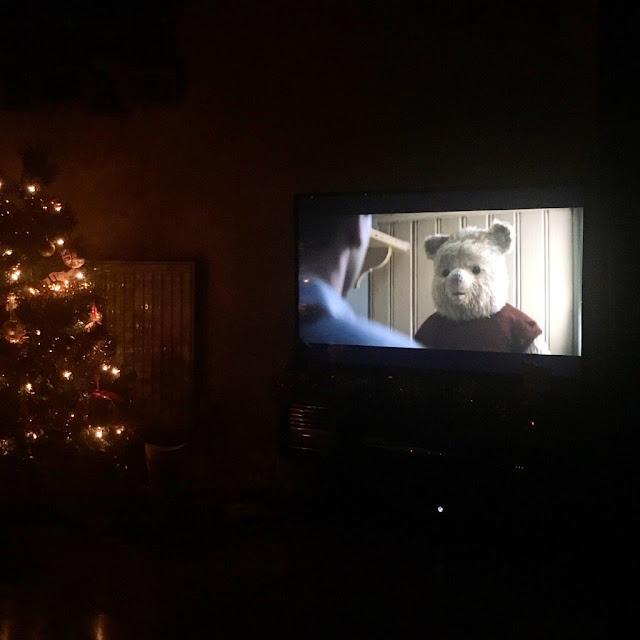 Christmas tree and Christopher Robin on the TV
