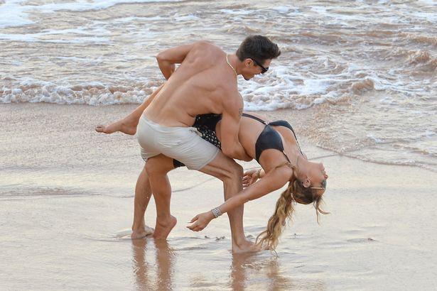PROD-EXCLUSIVE-Mariah-Carey-and-Bryan-Tanaka-Pack-On-The-PDA-Causing-A-Nip-Slip-In-Hawaii